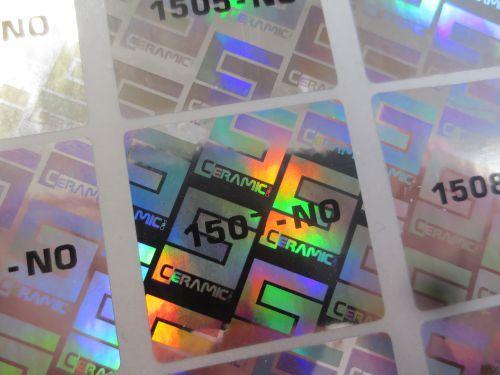 Holografiske klistremerker med nummerering levert denne uken.